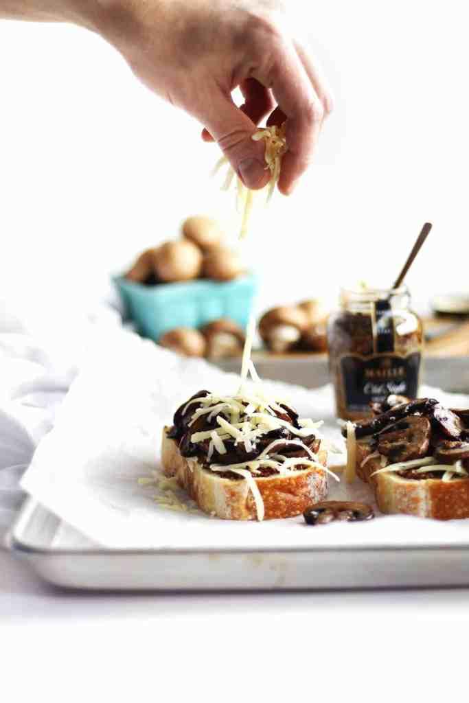 cheese sprinkled on mushroom toast