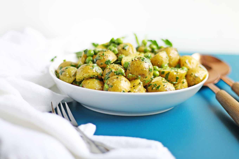 herb potato salad in a white bowl
