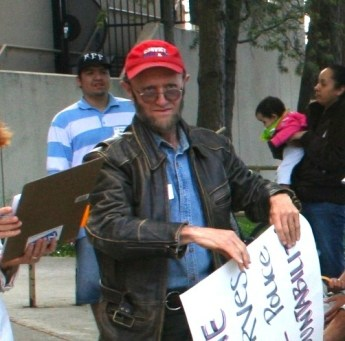 Dan (with Shonto Pete behind) at a police accountability rally the year before he passed.