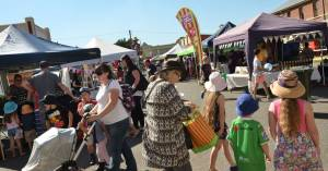 Festival goers line Broadway browsing stalls and listening to live music