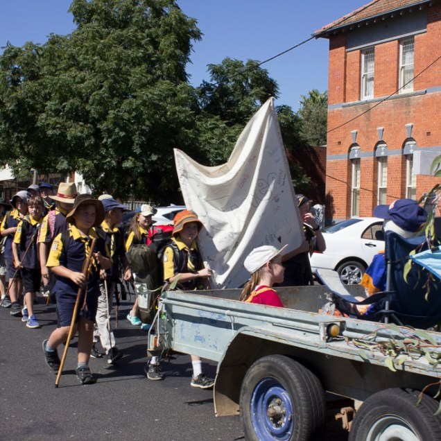 1st Junee Scout Group aboard their floating Campsite float and marching in the 2018 Junee Rhythm n Rail Festival's Street Parade