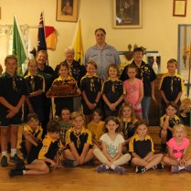 1st Junee Scout Group, with Linda Calis, Rhythm n Rail Secretary, and Nicholas Pyers, RnR President at Trophy presentation. Cub Scout Rylee Henderson, is proudly holding the Trophy
