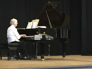 Mrs Jean Stanyer playing the Athenium Theatre's Grand Piano during the Junee Combined Church Service