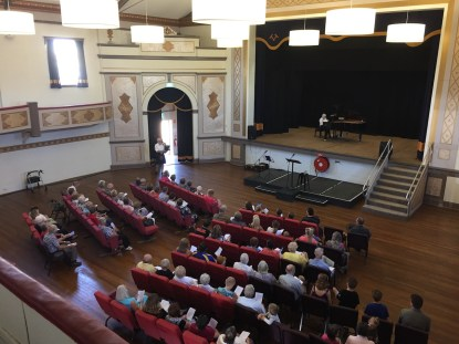 Mr Kim Martel playing the Bagpipes and Mrs Jean Stanyer accompanying on the piano at the Junee Combined Church Service held in the Athenium Theatre