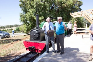 The Hon. Tim Fischer AC and Mr Peter Neve OAM — two rail enthusiasts standing on Loftus Station at Pete's Hobby Railway