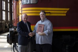 Junee Rhythm n Rail President, Nicholas Pyers (right) presenting a commemorative plaque to the Festival's Patron, The Hon. Tim Fischer AC.