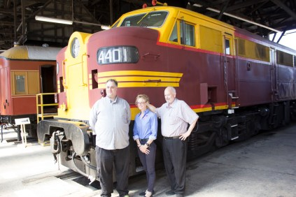 Rhythm n Rail President, Nicholas Pyers; Member for Cootamundra, Steph Cooke MP; Andrew Clinton, Junee Railway Workshop Director, in front of 4401 after the Festival Media Launch