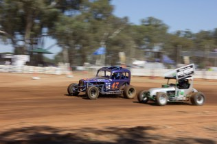 Brian Bury in his 60's Modified #47 makes an outside pass on Dick Druiry in car #8 at Illabo Motorsports Park