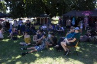 Relaxing in the shade whilst listening to live performances on the Main Stage in Memorial Park