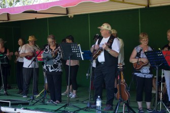 S.T.R.U.M (Super Talented Wagga Ukulele Musicians) performing on the Main Stage in Memorial Park