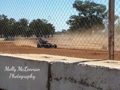 A view from behind the safety fence of Vintage Speedway's elder statesmen Gordon Benny (87 year young) in his Offenhauser Midget at Illabo Motorsports Park
