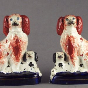 ANTIQUE PAIR OF STAFFORDSHIRE FIGURES OF SPANIELS & PUPS