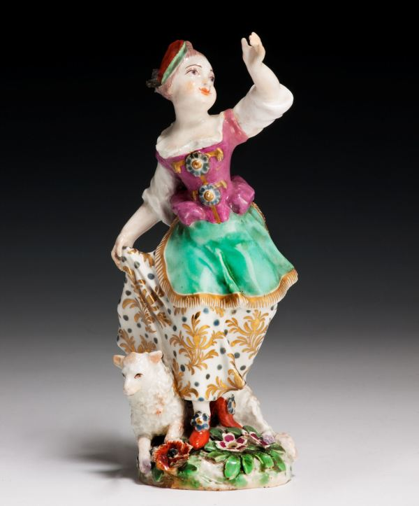 ANTIQUE CHELSEA PORCELAIN FIGURE OF A GIRL AND SHEEP