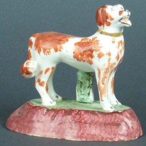 ANTIQUE STAFFORDSHIRE FIGURE OF RED & WHITE GUNDOG