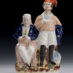 ANTIQUE STAFFORDSHIRE FIGURE OF HAM AND PEGGOTTY