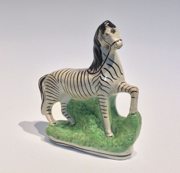 ANTIQUE STAFFORDSHIRE FIGURE OF A ZEBRA FOR SALE