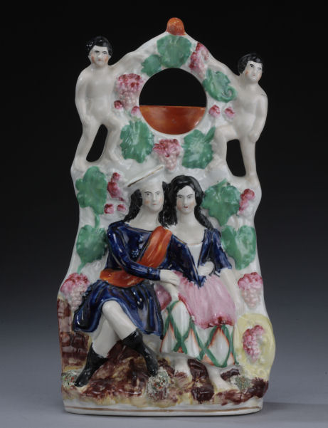 ANTIQUE STAFFORDSHIRE FIGURE OF A WATCH HOLDER