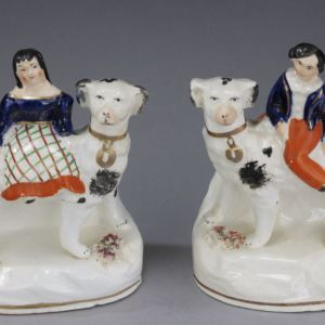 ANTIQUE STAFFORDSHIRE FIGURES OF CHILDREN ON DOGS