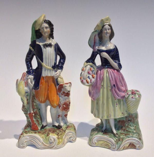 PAIR ANTIQUE STAFFORDSHIRE FIGURES OF A MAN AND WOMAN FOR SALE