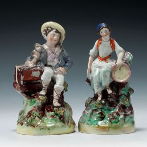 PAIR ANTIQUE STAFFORDSHIRE FIGURES OF MUSICIANS
