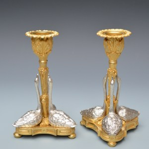PAIR OF GILT AND SILVERED BRONZE SWAN CANDLESTICKS
