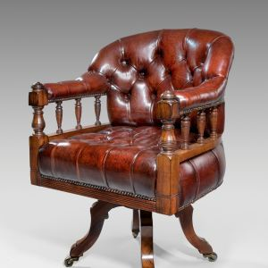 ANTIQUE LEATHER COVERED ROSEWOOD REVOLVING DESK CHAIR