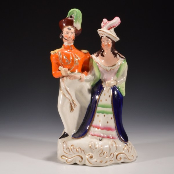 ANTIQUE STAFFORDSHIRE FIGURE OF A SOLDIER & HIS GIRL