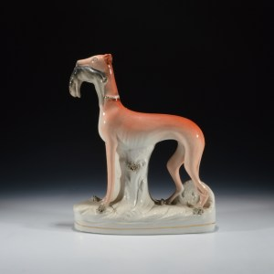ANTIQUE STAFFORDSHIRE FIGURE OF A STANDING WHIPPET