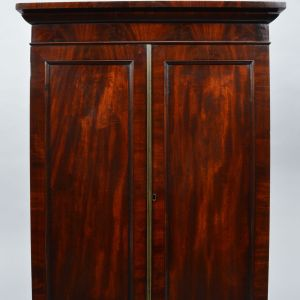 ANTIQUE REGENCY MAHOGANY AND MAPLE CORNER CUPBOARD