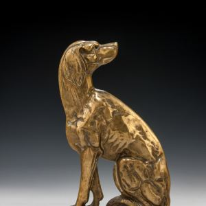 ANTIQUE BRASS DOOR STOP OF A SEATED DOG