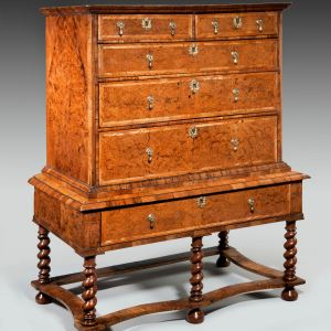 ANTIQUE WILLIAM AND MARY ELM CHEST ON STAND