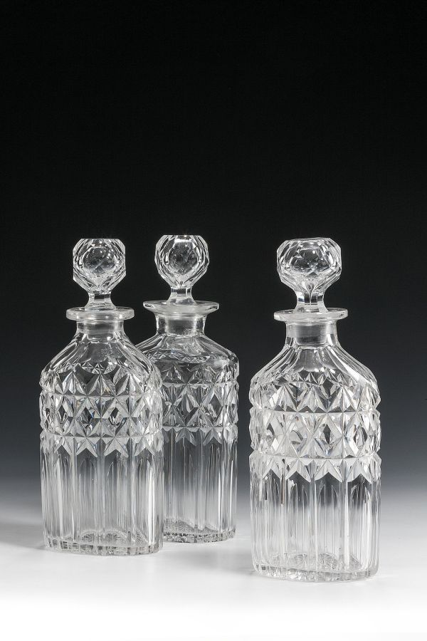 THREE ANTIQUE GLASS DECANTERS