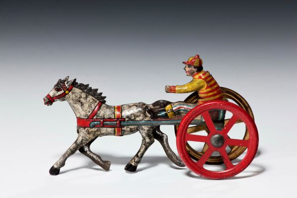 ANTIQUE PENNY TOY OF A TROTTING HORSE BY MEIER