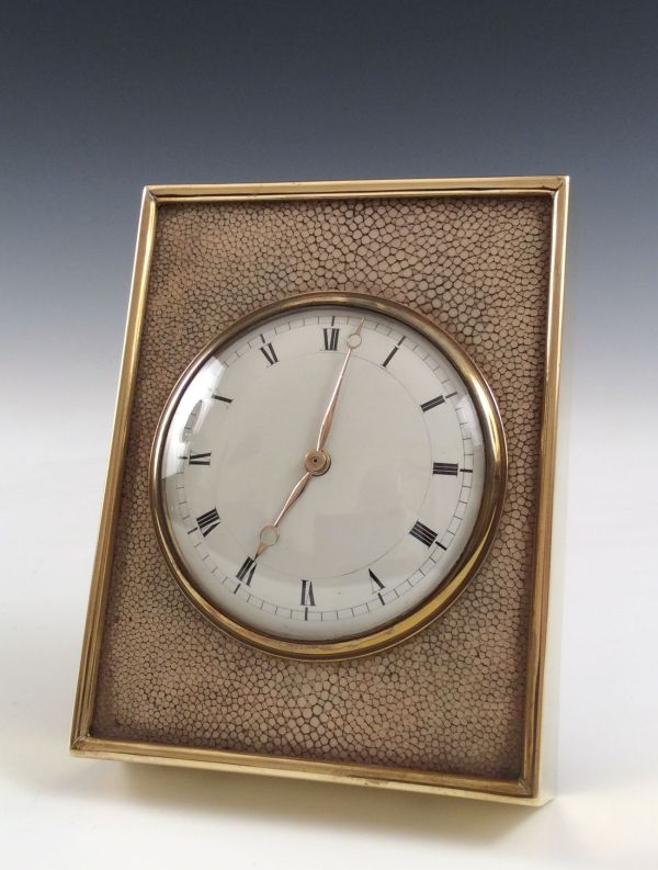 ANTIQUE SHAGREEN AND GILT BRONZE STRUT CLOCK