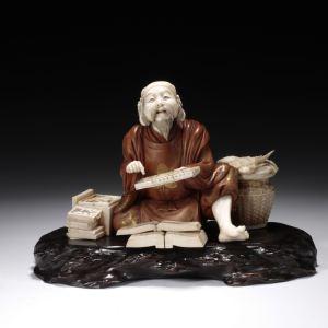 JAPANESE WOOD AND IVORY OKIMONO OF EBISU