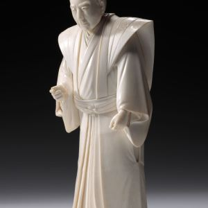 JAPANESE IVORY OKIMONO OF A SAMURAI TEACHER