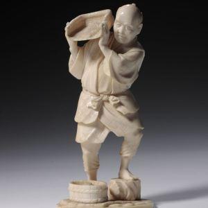 JAPANESE IVORY OKIMONO OF A FARMER