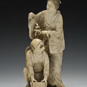 JAPANESE IVORY OKIMONO OF A WOMAN AND RAT CATCHER