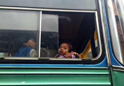 An Embera baby on a public bus in Bogota