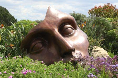Art face mask in flower garden