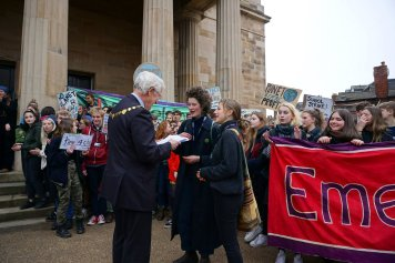 Students lobbying Councilors to declare a Climate Emergency