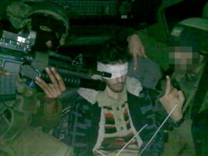 Prison for IDF Soldiers Who Gave Blindfolded Palestinian Prisoner the Finger, Brandished Loaded Weapons in His Face