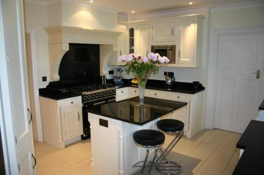 Counters, centre island and oven range splashback in Belfast Black
