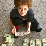 Image of a child counting his money