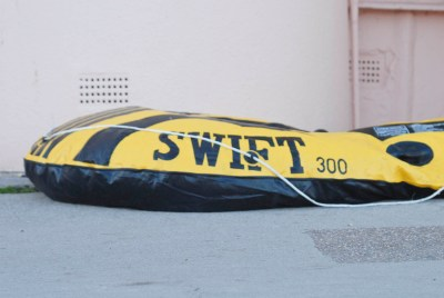 deflated rubber inflatable dinghy lyme regis dorset england