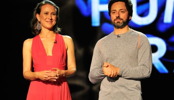 MOUNTAIN VIEW, CA - DECEMBER 12: Anne Wojcicki and Sergey Brin (L-R) are presenters at the 2014 Breakthrough Prizes Awarded in Fundamental Physics and Life Sciences Ceremony at NASA Ames Research Center on December 12, 2013 in Mountain View, California. (Photo by Steve Jennings/Getty Images for MerchantCantos)