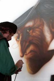 Painting a mural of The Scrooge