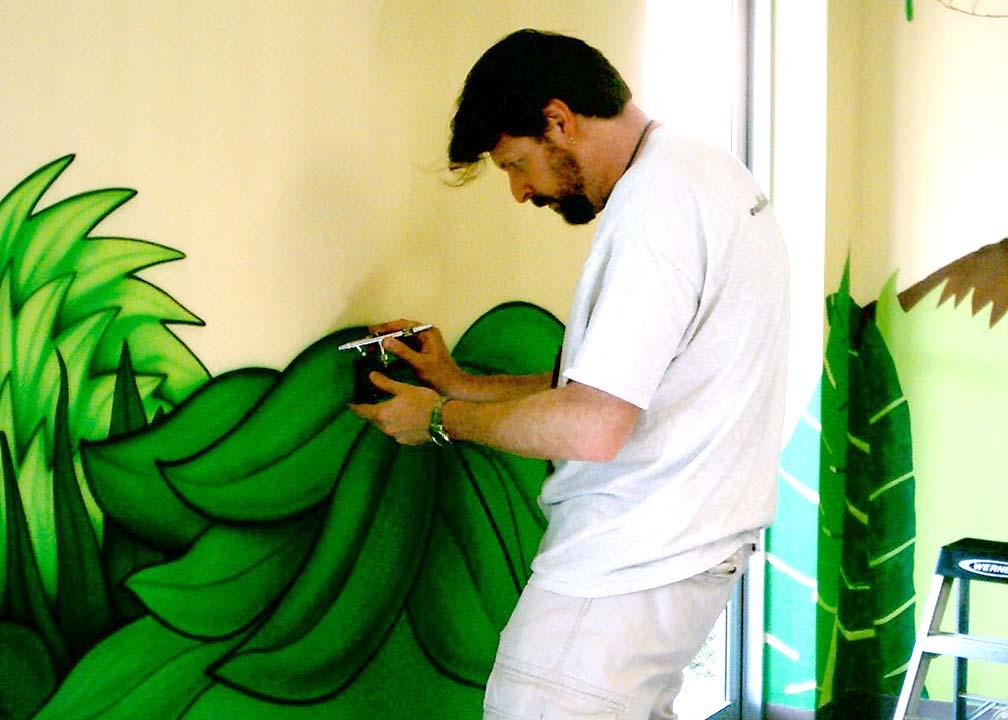 Atlanta Muralist Rick Baldwin Painting a Wall Mural