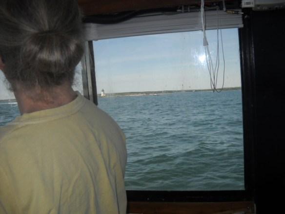 The XO at the helm. Rounding Bird Island Light.