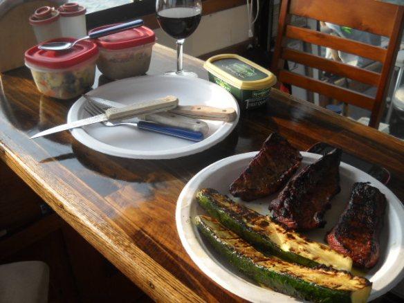 Steak tip, grilled zuchini, and olive salad.
